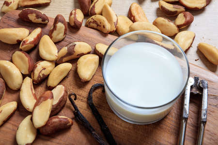 Milk from brazil nuts on a wooden surface Stock Photo