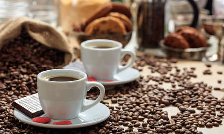 coffee cups: Coffee beans and two cups of coffee