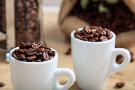 coffee cups: Cups full of coffee beans