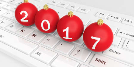 year greetings: 3d rendering christmas balls on a white keyboard Stock Photo