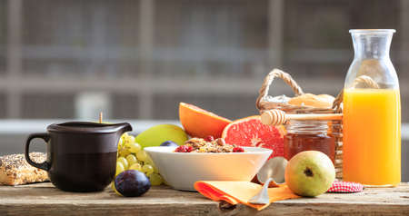 cereal bowl: Fresh fruits and cereal bowl on a wooden table Stock Photo