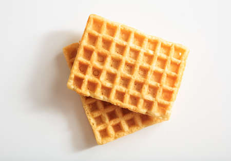 Two waffles on white background