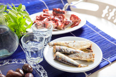 blue fish: Glasses of ouzo and appetizers