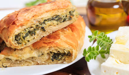 Spinach pie pieces in a plate