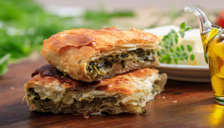 Spinach pie pieces on a wooden table