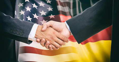 Formal handshake on USA - Germany flags background