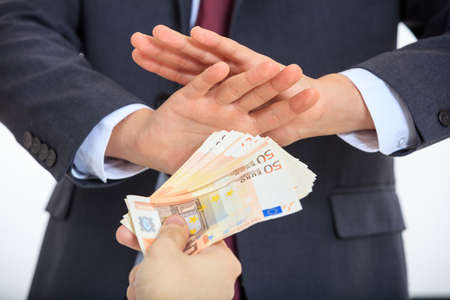 denying: Man in suit denying money Stock Photo