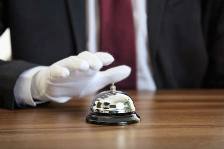 Butler service bell on a wooden surface Stock Photo
