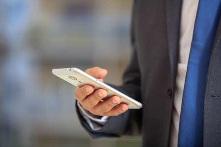 Businessman holding a mobile phone Zdjęcie Seryjne