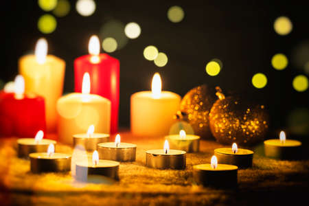 White and red candles on a dark background