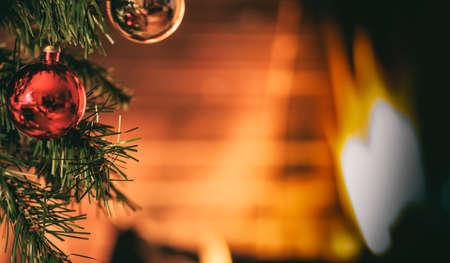 yule log: Christmas tree near a fireplace