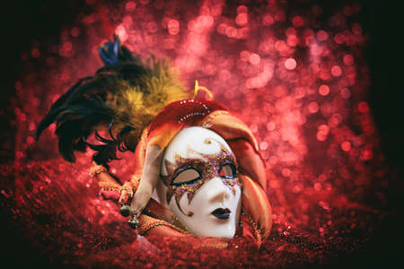 red blur: Carnival mask isolated on red blur background Stock Photo