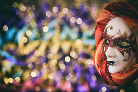 arlecchino: Harlequin carnival mask on colorful blur background