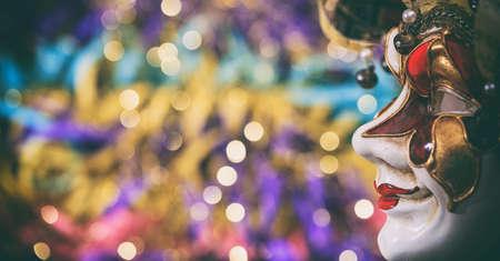 harlequin: Harlequin carnival mask on colorful blur background
