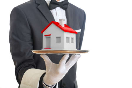 offering: 3d rendering waiter offering a house on a tray