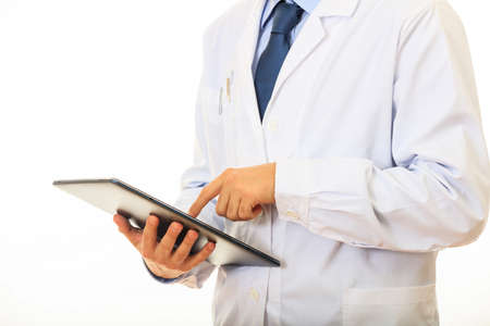 Doctor holding working with a tablet on white background