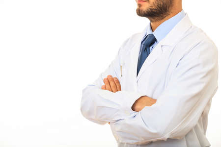 crossing arms: Doctor with crossing arms standing on white background
