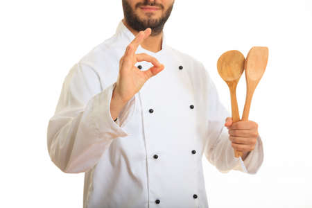 sho: Chef holding wooden spoons isolated on white background