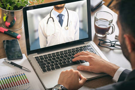 Doctor on a computer screen in an office environment