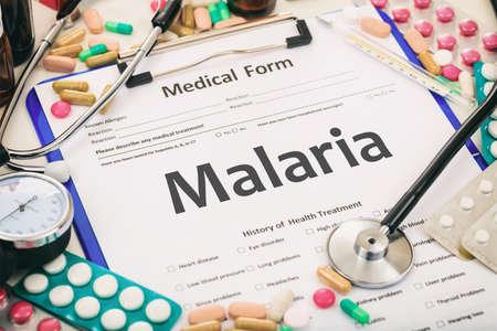 malaria: Medical form on a table, diagnosis malaria