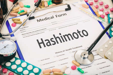 Medical form on a table, diagnosis hashimoto thyroiditis