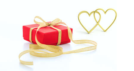 3d rendering golden joined hearts and a gift on white background Stock Photo