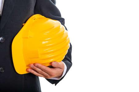 Engineer holding a hard hat on white background Zdjęcie Seryjne