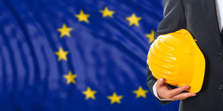 waiving: Engineer on a waiving European Union flag background. 3d illustration