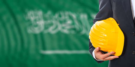 waiving: Engineer on a waiving Saudi Arabia flag background. 3d illustration