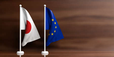 Japan and European Union miniature flags on wooden background. 3d illustration