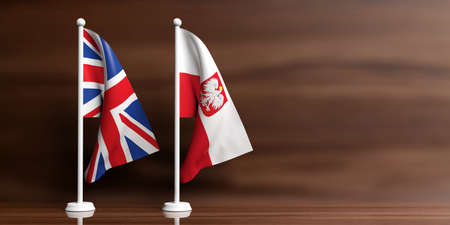 Poland and Great Britain miniature flags on wooden background. 3d illustration Stock Photo