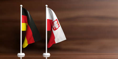 Poland and Germany miniature flags on wooden background. 3d illustration