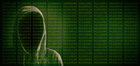 Hooded faceless man on binary code background Stock Photo