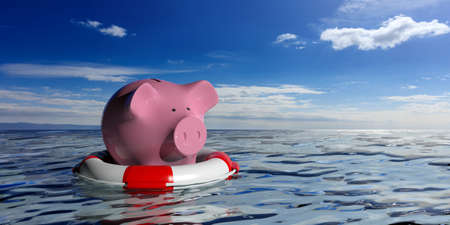 Life buoy and a piggy bank on blue sea and sky background. 3d illustration Stockfoto
