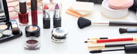 Set of makeup cosmetics on white background