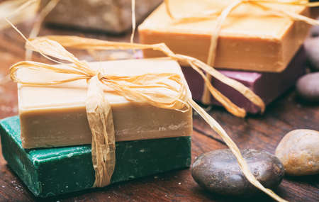 Natural handmade soap bars on wooden background