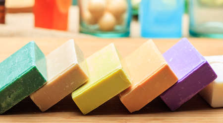 Variety of handmade soap bars on wooden background Stock Photo