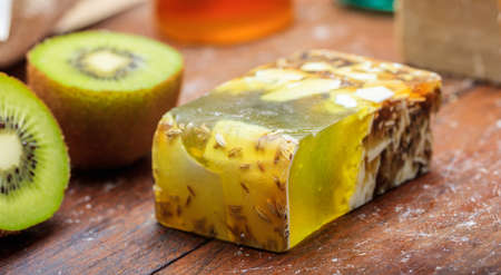 Natural handmade soap bar on wooden background
