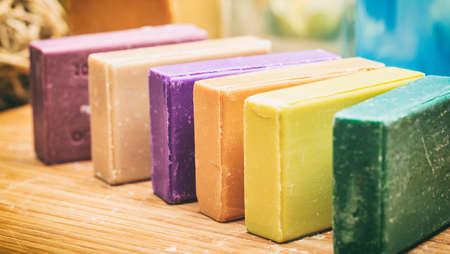 Variety of handmade soap bars on wooden background Standard-Bild