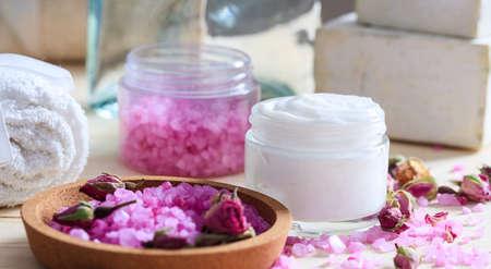 cremas faciales: Variety of creams and bath salt on wooden background Foto de archivo