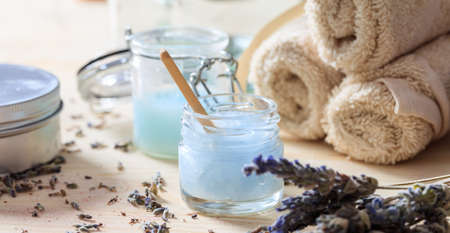 Moisturizing creams and lavender on wooden background Stock Photo