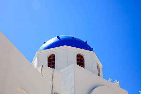 Santorini, Greece - White church with blue dome on blue sky background Stock Photo