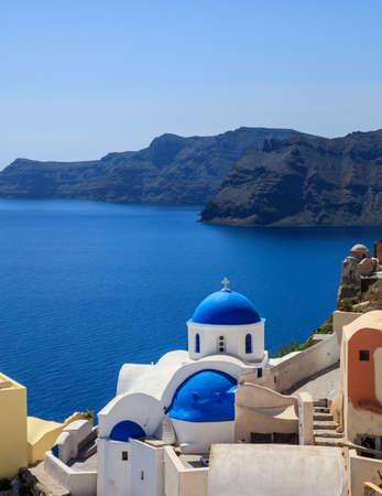 Santorini, Greece - White church with blue dome and caldera view