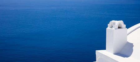Santorini island, Greece - White chimney on blue sea background