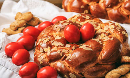 Easter traditional bread and red eggs on a table Stock Photo - 75594405