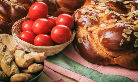 Easter traditional bread and red eggs on a table