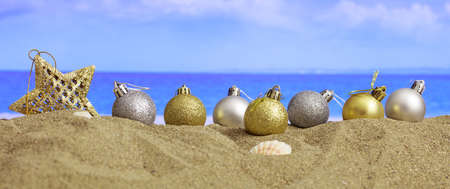 Christmas balls on a sandy beach