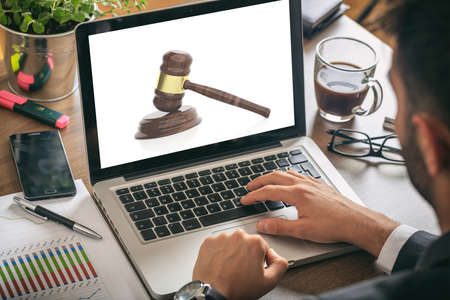 Law concept - Judge gavel on a laptop screen