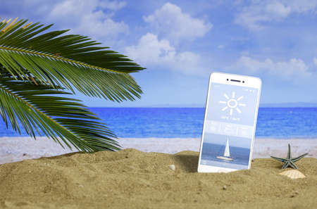 Summer vacations - Smartphone with weather app on a sandy beach. 3d illustration