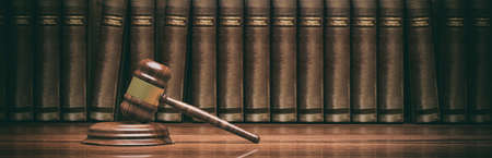 Law theme. Wooden gavel and books. 3d illustration